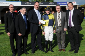 "Flexitrans' Director Jamie Read presenting ""Best turned out horse in the race"" prize"